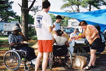 group with wheelchair at campsite